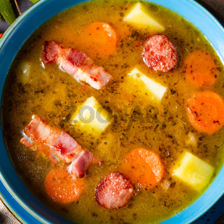 polish pea soup (grochowka) with smoked bacon and sausage