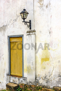 Old light lantern and aged wooden window