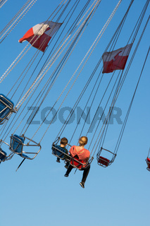 Mother and Son Swing Ride Fair Blue Sky Festival Swinging