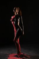 Nude girl with red and black bodyart view