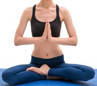 Yoga instructor sitting in lotus position