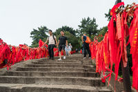 Tourists walking on steps on trail on Huashan Mountain