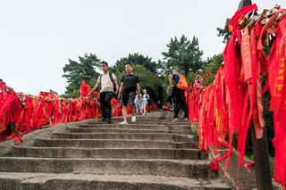 Tourists walking on steps on trail on Huashan Mountain