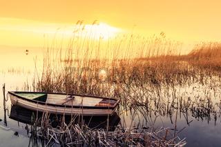 Sunset on the lake Balaton with a boat