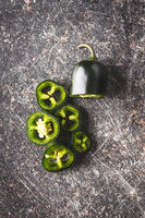 Sliced green jalapeno pepper.