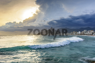 Cloudy sunset with surfers at Ipanema beach