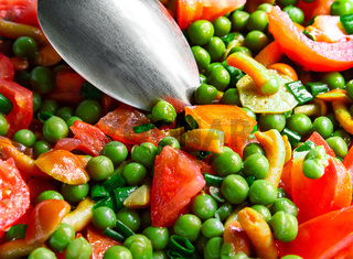 Tomatoes with mushrooms and green peas