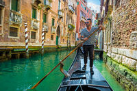 Gondolier on canal of venice