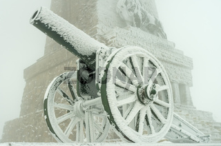 An old metal cannon. The cannon participated in the battles of liberation of Bulgaria in 1877. Winte