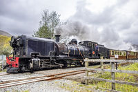 Ffestiniog, Wales - May 03 2018: Ffestiniog Steam Railway passing by in Snowdonia National Park, Wales, United Kingdom, Europe