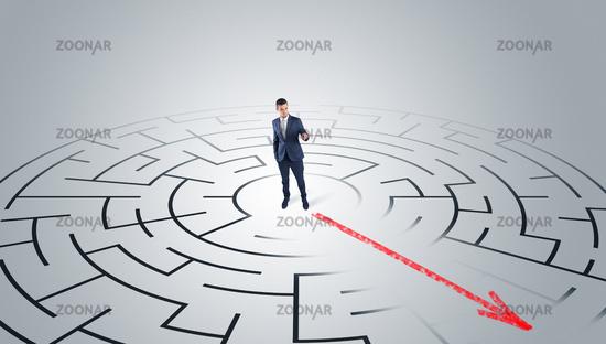 Businessman going through the maze