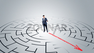Businessman going through the maze