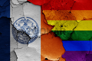flags of New York City and LGBT painted on cracked wall