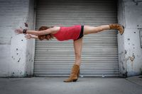 Urban Yoga: A Female Yogi Practices Outdoors in the City