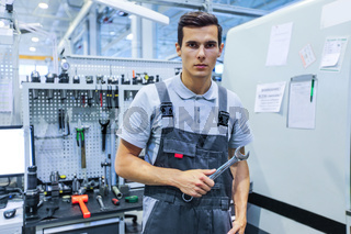 Worker with wrench at workplace