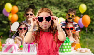 naughty red haired girl in heart shaped sunglasses