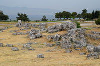 Fragments of ancient buildings, ruins of the ancient city of Hierapolis. Stone blocks with traces of stone machining.