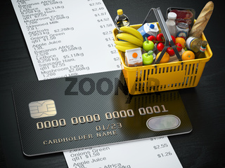 Shopping basket with food and drink, cerdit card and receipt with list of expenses.Purchasing products onlaine by credit card or family budjet concept.