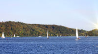 Scenery with sailing boat on lake Baldeney