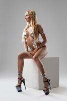 Slim blonde with silver tape bodyart shot