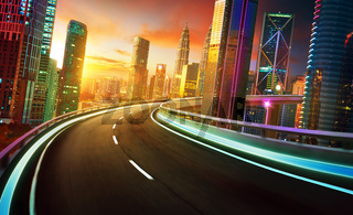 Highway overpass motion blur with city skyline and urban skyscrapers