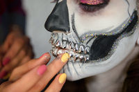 Makeup artist puts greasepaint of a adorable lady
