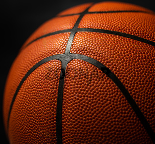 Basketball under the light with a black background