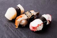 Nigiri sushi set on black slate board