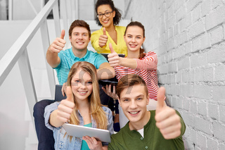 high school students with tablet computers