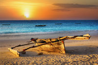 Traditional fishing boat on the ocean at sunset. Zanzibar