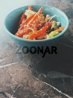 Vegetarian asian vegetable salad served in a bowl in japanese restaurant, healthy diet food