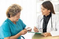Doctor prescribing pills patient