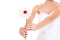 Closeup of bride white wedding dress with flower