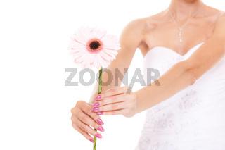 Closeup of bride white wedding dress with flower