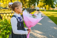 Beautiful little girl with big bouquet of flowers