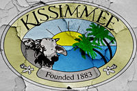 flag of Kissimmee painted on cracked wall