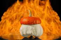 Pumpkin lies on the background of fire