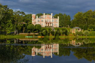 Birini palace and mirror reflection in Birinyu lake, Latvia