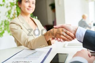 Elegant  Businesswoman Shaking Hands with Partner