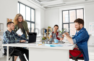 creative team working on user interface at office