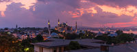 Sultan Ahmet Mosque also know as the Blue Mosque and the Boshorus, sunset panorama, Istanbul, Turkey
