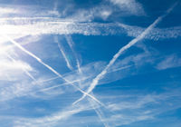 FLIGHT CONTRAILS IN THE SKY