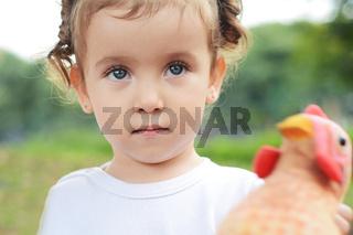 Portrait of baby girl in park.