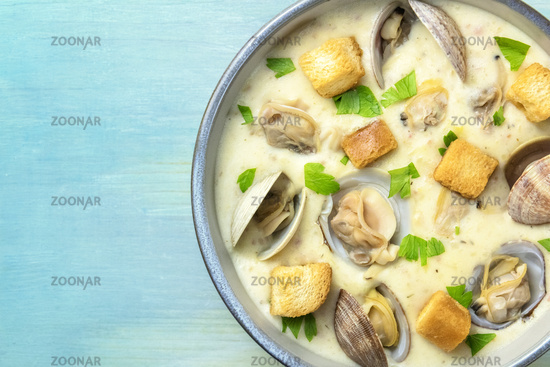 Clam chowder with fresh parsley and croutons, closeup shot from above with copy space