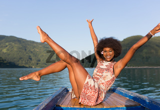 Attractive afro american girl on a yacht at summer day posing. Atmospheric and happy photo.