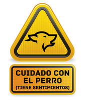 Beware of the dog plate with spanish text.