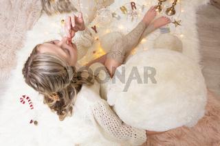 Female eating festive popcorn at Christmas time