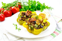 Pepper stuffed with vegetables in plate on light board