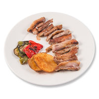 Grilled Secreto of Spanish Iberico pork cut with potatoes and grilled vegetables