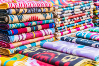 Traditional Asian cloth sold in a store in the Historic Centre of Bukhara